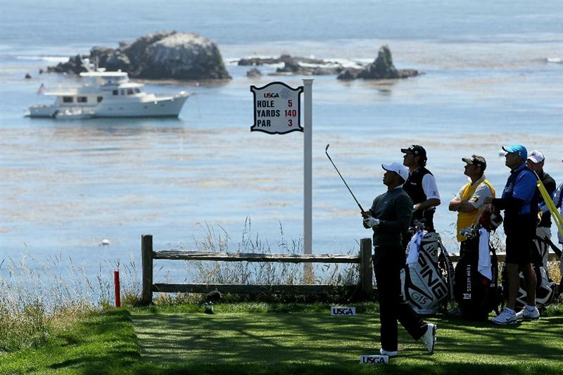 PEBBLE BEACH, CA - JUNE 17:  Tiger Woods watches his tee shot on the fifth hole during the first round of the 110th U.S. Open at Pebble Beach Golf Links on June 17, 2010 in Pebble Beach, California.  (Photo by Jeff Gross/Getty Images)