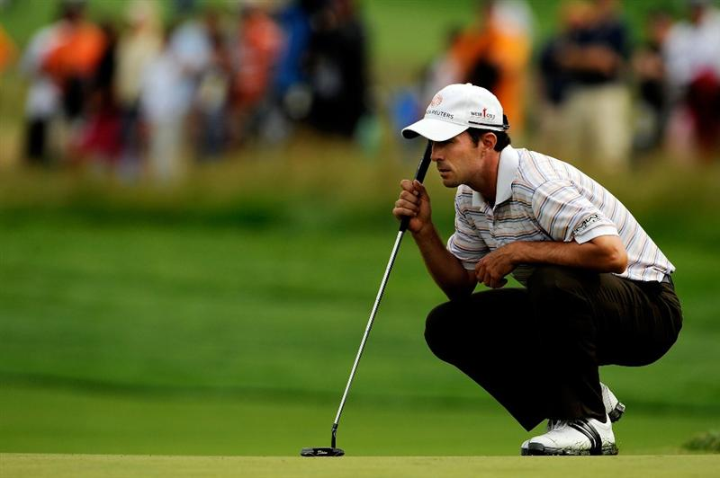 FARMINGDALE, NY - JUNE 20:  Mike Weir of Canada lines up a putt on the 17th green during the continuation of the second round of the 109th U.S. Open on the Black Course at Bethpage State Park on June 20, 2009 in Farmingdale, New York.  (Photo by Sam Greenwood/Getty Images)