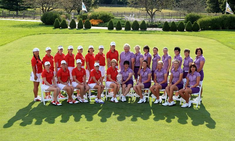 SUGAR GROVE, IL - AUGUST 18: The USA and European teams pose together with the trophy during the official team photocall as a preview for the 2009 Solheim Cup Matches, at the Rich Harvest Farms Golf Club on August 18, 2009 in Sugar Grove, Ilinois  (Photo by David Cannon/Getty Images)