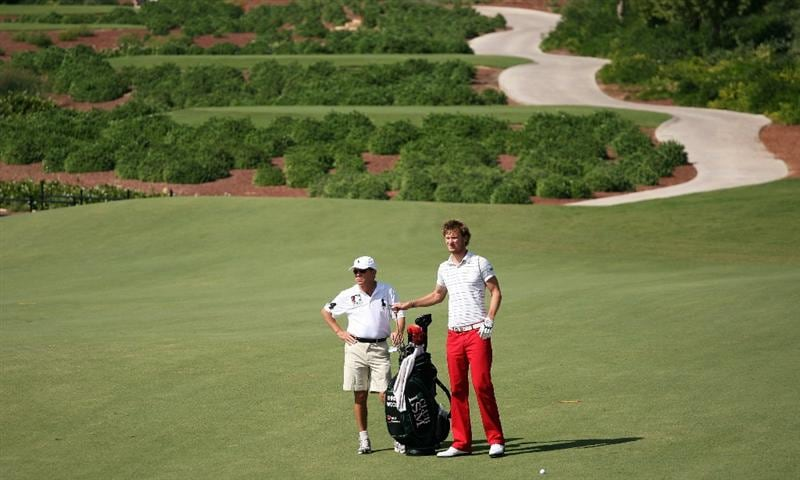 DUBAI, UNITED ARAB EMIRATES - NOVEMBER 19:  Chris Wood of England waits with his caddie Dave McNeilly on the 16th hole during the first round of the Dubai World Championship on the Earth Course, Jumeirah Golf Estates on November 19, 2009 in Dubai, United Arab Emirates.  (Photo by Andrew Redington/Getty Images)