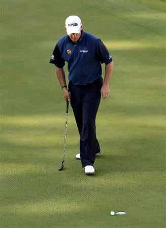 VIRGINIA WATER, ENGLAND - MAY 29:  Lee Westwood of England reacts to a missed putt on the 18th green during the final round of the BMW PGA Championship  at the Wentworth Club on May 29, 2011 in Virginia Water, England.  (Photo by Andrew Redington/Getty Images)