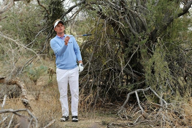 MARANA, AZ - FEBRUARY 26:  Luke Donald of England evaluates his second shot on the 11th hole during the semifinal round of the Accenture Match Play Championship at the Ritz-Carlton Golf Club on February 26, 2011 in Marana, Arizona.  (Photo by Stuart Franklin/Getty Images)