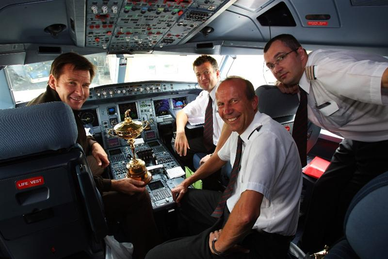 LONDON - SEPTEMBER 15:  Ryder Cup captain Nick Faldo poses in the cockpit with Virgin Atlantic pilots and the Trophy at Heathrow airport before heading to the United States with Team Europe for the Ryder Cup on September 15, 2008 in London, England. The 2008 Ryder Cup will be held at Valhalla Golf Club in Louisville, Kentucky over the weekend of 19-21 September.  (Photo by Andrew Redington/Getty Images)