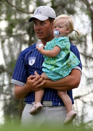 ORLANDO, FL - MARCH 17:  Henrik Stenson celebrates his team's victory with daughter Lisa at the Tavistock Cup on March 17, 2009 at Lake Nona Country Club in Orlando, Florida.  (Photo by Marc Serota/Getty Images)