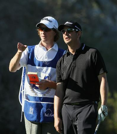 LA QUINTA, CA - JANUARY 21:  Matt McQuillan (R) of Canada and his caddie discuss his tee shot on the 18th hole during the third round of the Bob Hope Classic at the Silver Rock Resort on January 21, 2011 in La Quinta, California.  (Photo by Jeff Gross/Getty Images)