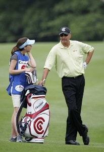 Lynn Pooley caddies for her father Don during the first round of the Commerce Bank Championship on the Red Course at Eisenhower Park  in East Meadow, New York on June 23, 2006.Photo by Michael Cohen/WireImage.com