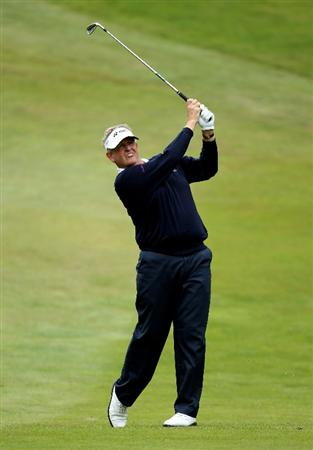 VIRGINIA WATER, ENGLAND - MAY 28:  Colin Montgomerie of Scotland hits an approach during the third round of the BMW PGA Championship at the Wentworth Club on May 28, 2011 in Virginia Water, England.  (Photo by Ian Walton/Getty Images)