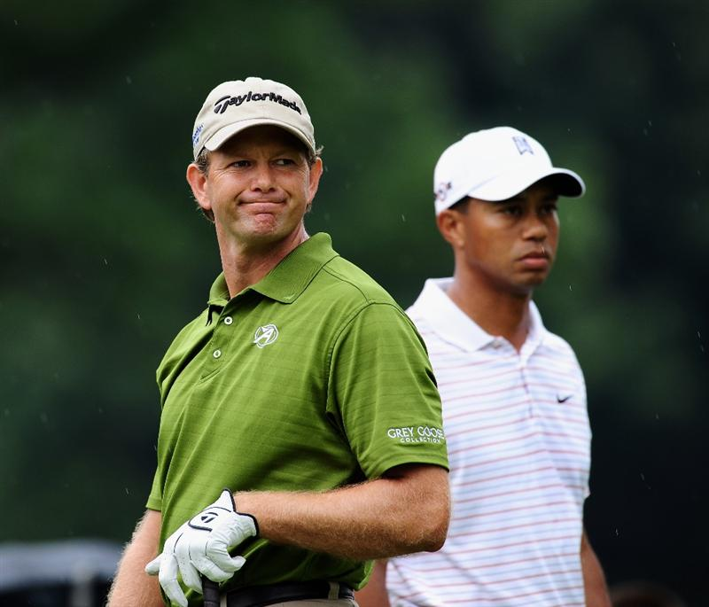 AKRON, OH - AUGUST 08:  Retief Goosen of South Africa and Tiger Woods of USA on the third hole during the third round of the World Golf Championship Bridgestone Invitational on August 8, 2009 at Firestone Country Club in Akron, Ohio.  (Photo by Stuart Franklin/Getty Images)