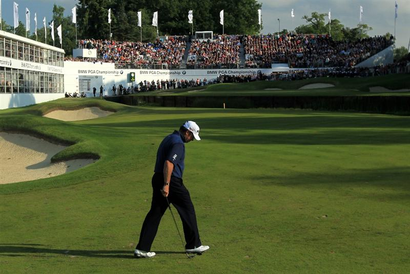 VIRGINIA WATER, ENGLAND - MAY 29:  Lee Westwood of England looks dejected after finding the water on the 18th hole in a playoff during the final round of the BMW PGA Championship  at the Wentworth Club on May 29, 2011 in Virginia Water, England.  (Photo by David Cannon/Getty Images)