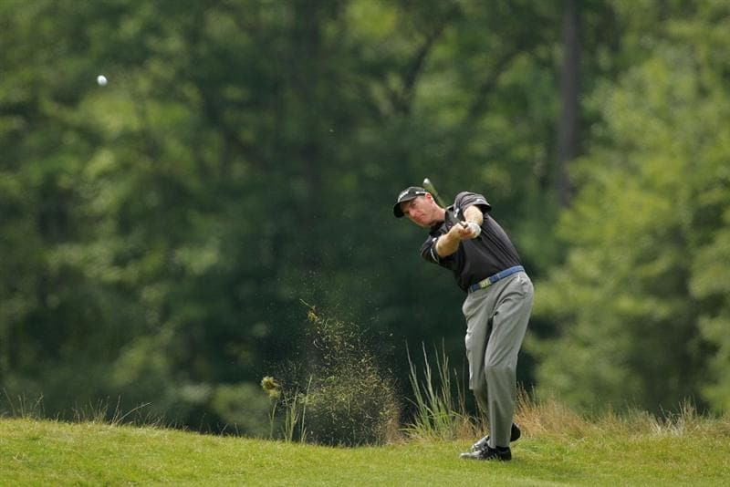 NORTON, MA - AUGUST 29:  Jim Furyk plays a shot from the rough during the first round of the Deutsche Bank Championship at TPC of Boston held on August 29, 2008 in Norton, Massachusetts.  (Photo by Michael Cohen/Getty Images)
