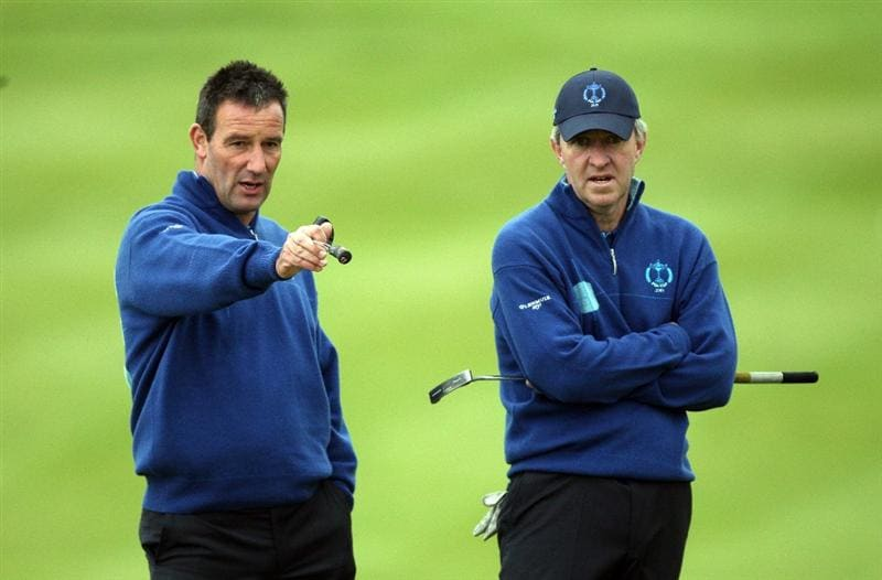 DUMBARTON, SCOTLAND - SEPTEMBER 19:  Paul Wesselingh of England (L) and Jeremy Robinson of England and the Great Britain and Ireland Team talk at the 10th during the morning foursome matches at The Carrick on Loch Lomond on September 19, 2009 in Dumbarton, Scotland.  (Photo by David Cannon/Getty Images)