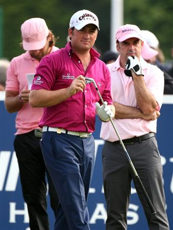 SUTTON COLDFIELD, UNITED KINGDOM - SEPTEMBER 26: Johan Edfors of Sweden, Graeme McDowell of Northern Ireland and Paul McGinley of Ireland wearing pink on Pink Friday / Ladies Day during the second round the Quinn Insurance British Masters at the Belfry on September 26, 2008 in Sutton Coldfield, England.  (Photo by Ross Kinnaird/Getty Images)