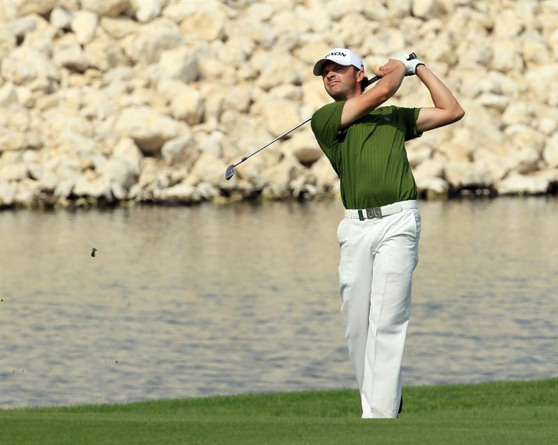 BAHRAIN, BAHRAIN - JANUARY 28:  Andrew Marshall of England plays his second shot at the 18th hole during the second round of the 2011 Volvo Champions held at the Royal Golf Club on January 28, 2011 in Bahrain, Bahrain.  (Photo by David Cannon/Getty Images)