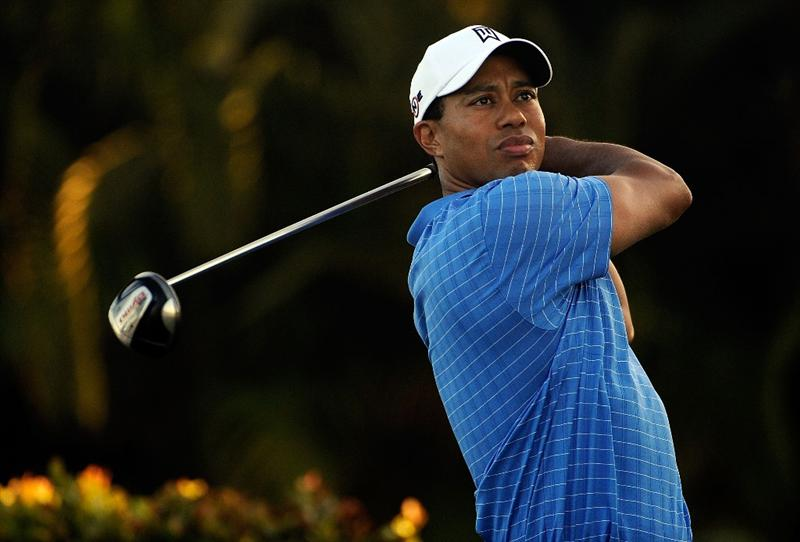 DORAL, FL - MARCH 11:  Tiger Woods watches a shot during the final day of practice for the World Golf Championships-CA Championship at the Doral Golf Resort & Spa on March 11, 2009 in Miami, Florida.  (Photo by Sam Greenwood/Getty Images)