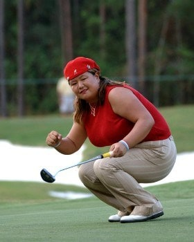 Christina Kim watches an eagle putt miss on the 16th green  during  the final round of the 2005 Mitchell Company Tournament of Champions November 13 in Mobile, Alabama. Kim won the tournament at 15 under par.Photo by Al Messerschmidt/WireImage.com