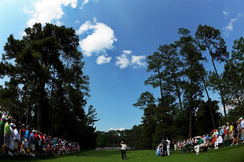 AUGUSTA, GA - APRIL 10:  K.J. Choi of South Korea hits his tee shot on the sixth hole during the final round of the 2011 Masters Tournament at Augusta National Golf Club on April 10, 2011 in Augusta, Georgia.  (Photo by Harry How/Getty Images)