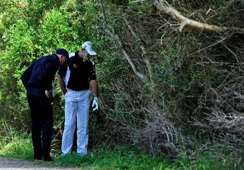 MALLORCA, SPAIN - MAY 15:  James Kingston of South Africa searches for his ball with referee Mikeal Eriksson on the 10th hole during the third round of the Open Cala Millor Mallorca at Pula golf club on May 15, 2010 in Mallorca, Spain.  (Photo by Stuart Franklin/Getty Images)