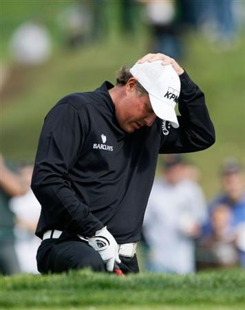 LA JOLLA, CA - FEBRUARY 08: Phil Mickelson looks down before hitting his second shot out of a bunker on the 11th hole during the final round of the the Buick Invitational at the Torrey Pines Golf Course on February 8, 2009 in La Jolla, California. (Photo by Jeff Gross/Getty Images)