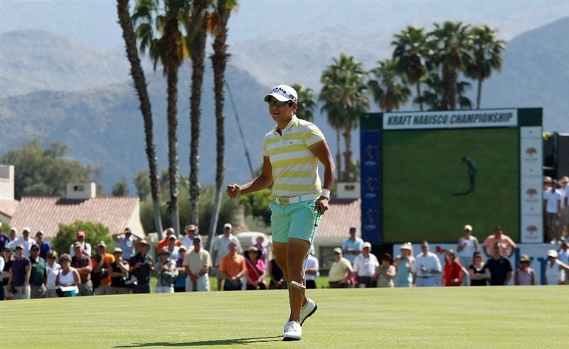 RANCHO MIRAGE, CA - APRIL 04:  Yani Tseng of Taiwan celebrates after leaving her putt for birdie on the edge of the hole securing her one shot victory on the 18th green during the final round of the 2010 Kraft Nabisco Championship, on the Dinah Shore Course at The Mission Hills Country Club, on April 4, 2010 in Rancho Mirage, California.  (Photo by David Cannon/Getty Images)