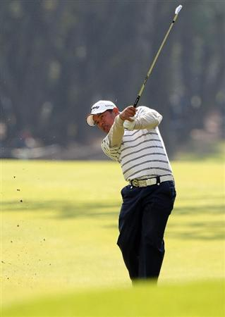 MIYAZAKI, JAPAN - NOVEMBER 21:  Prayad Marksaeng of Thailand hits his approach shot on the 17th hole during the second round of the Dunlop Phoenix Tournament 2008 at Phoenix Country Club on November 21, 2008 in Miyazaki, Japan.  (Photo by Koichi Kamoshida/Getty Images)