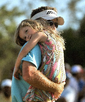 QUINTANA ROO, MEXICO - FEBRUARY 24:  Brian Gay carries his daughter Brantley off the 18th green after winning  the Mayakoba Golf Classic at Riviera Maya on Sunday, February 24, 2008 in Playa del Carmen, Quintana Roo, Mexico. (Photo by Marc Feldman/Getty Images)