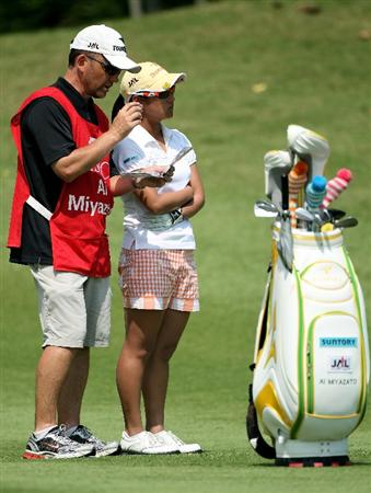 SINGAPORE - FEBRUARY 28:  Ai Miyazato of Japan stands by her golf bag on her way to victory in the HSBC Women's Champions at the Tanah Merah Country Club on February 28, 2010 in Singapore.  (Photo by Andrew Redington/Getty Images)