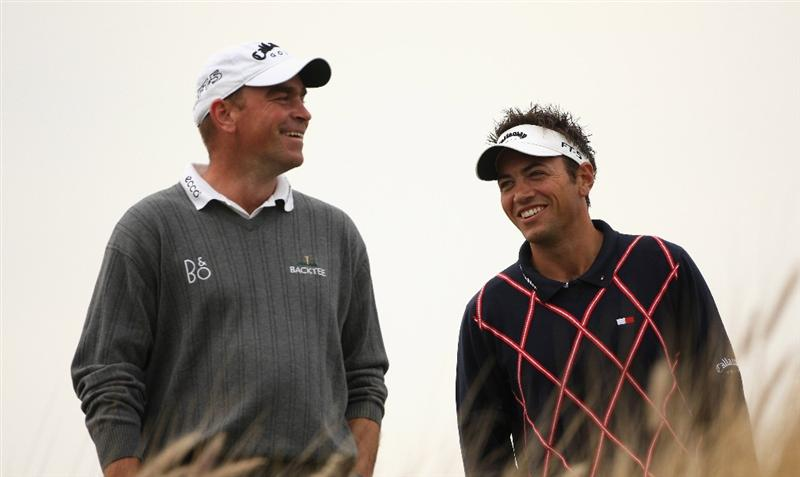 DOHA, QATAR - JANUARY 23:  Thomas Bjorn of Denmark (left) shares a joke with Nick Dougherty of England on the 16th hole during the second round of  the Commercialbank Qatar Masters at Doha Golf Club on January 23, 2009 in Doha, Qatar.  (Photo by Andrew Redington/Getty Images)