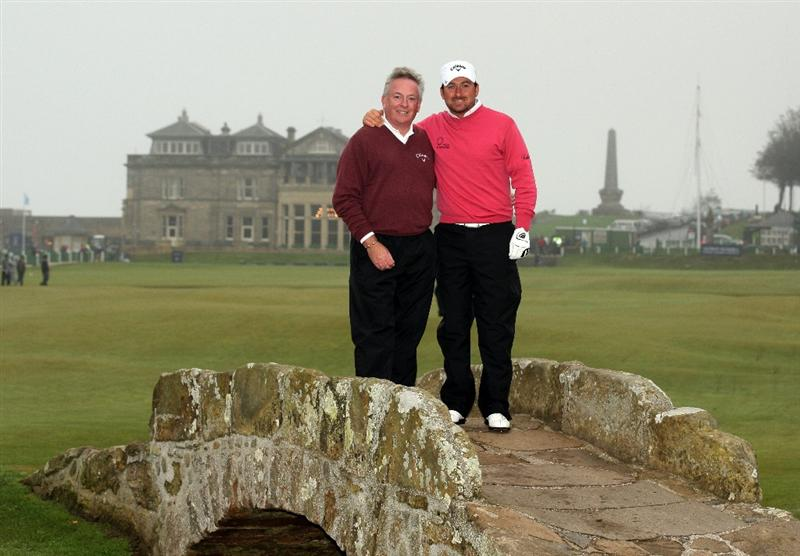 ST ANDREWS, SCOTLAND - OCTOBER 08:  Graeme McDowell of Northern Ireland with his father and playing partner Kenny McDowell on the Swilken Bridge during the second round of The Alfred Dunhill Links Championship at The Old Course on October 8, 2010 in St Andrews, Scotland.  (Photo by Warren Little/Getty Images)