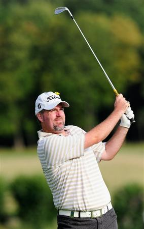 PARIS - SEPTEMBER 23:  Kenneth Ferrie of England plays his approach shot on the 14th hole during the first round of the Vivendi cup at Golf de Joyenval on September 22, 2010 in Chambourcy, near Paris, France.  (Photo by Stuart Franklin/Getty Images)