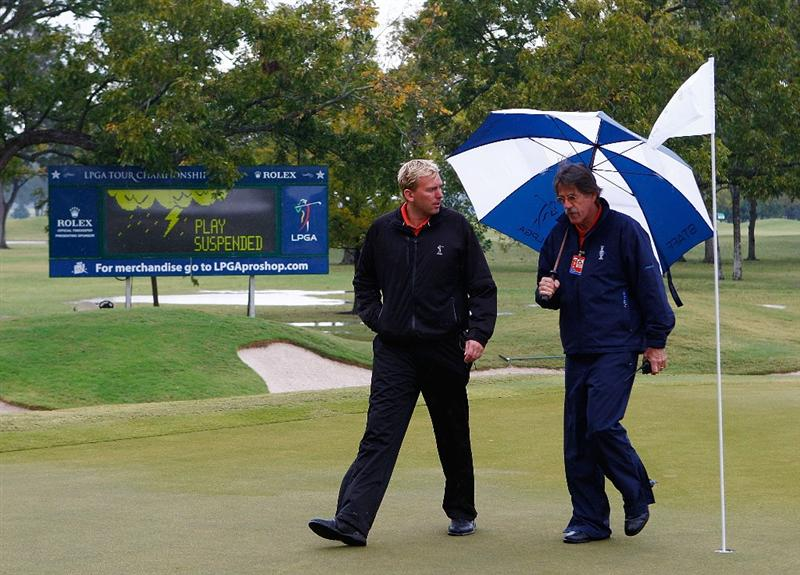RICHMOND, TX - NOVEMBER 21:  LPGA rules officials, (L-R)  Brad Alexander and Jim Haley look over the state of the golf course after play was delayed at the start of the second round of the LPGA Tour Championship presented by Rolex at the Houstonian Golf and Country Club on November 21, 2009 in Richmond, Texas.  (Photo by Scott Halleran/Getty Images)