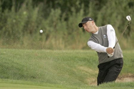 Soren Hansen blasts out of the sand during the rain delayed first round of the 2005 Deutsche Bank Players' Championship at Gut Kaden Golf Club in Hamburg, Germany on July 22, 2005.Photo by Pete Fontaine/WireImage.com