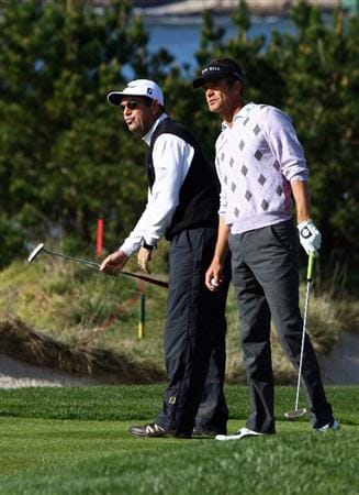 PEBBLE BEACH, CA - FEBRUARY 14: Huey Lewis and partner Jesper Parnevik watch a putt along with on the fourth hole during the third round of the AT&T Pebble Beach National Pro-Am at the Pebble Beach Golf Links on February 14, 2009 in Pebble Beach, California. (Photo by Jeff Gross/Getty Images)