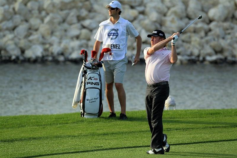 BAHRAIN, BAHRAIN - JANUARY 30: Miguel Angel Jimenez of Spain plays his second shot at the 18th hole during the final round of the 2011 Volvo Champions held at the Royal Golf Club on January 30, 2011 in Bahrain, Bahrain.  (Photo by David Cannon/Getty Images)
