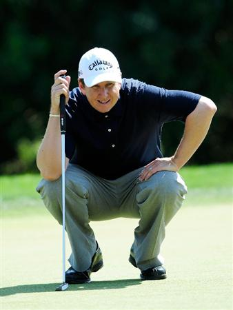 PALM HARBOR, FL - MARCH 20:  J. J. Henry looks over a birdie putt on the 7th hole during the second round of the Transitions Championship at the Innisbrook Resort and Golf Club on March 20, 2009 in Palm Harbor, Florida.  (Photo by Sam Greenwood/Getty Images)