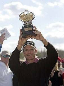 Jerry Pate holds the championship trophy after winning the 2006 Outback Steakhouse Pro-Am at the TPC of Tampa Bay, Tampa, Florida, Feb. 25, 2006.Photo by Hunter Martin/WireImage.com