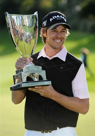 PACIFIC PALISADES, CA - FEBRUARY 20:  Aaron Baddeley of Australia poses with the trophy after the final round of the Northern Trust Open at Riviera Country Club on February 20, 2011 in Pacific Palisades, California.  (Photo by Stuart Franklin/Getty Images)