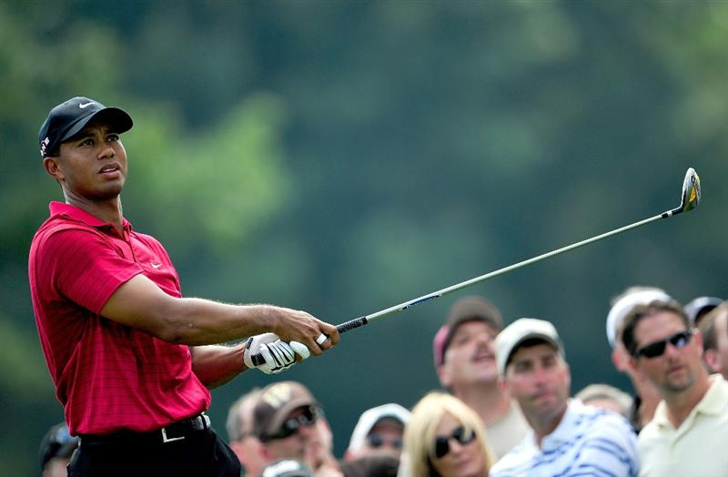 AKRON, OH - AUGUST 09:  Tiger Woods plays a shot on the 3rd hole during the final round of the WGC-Bridgestone Invitational on the South Course at Firestone Country Club on August 9, 2009 in Akron, Ohio.  (Photo by Sam Greenwood/Getty Images)
