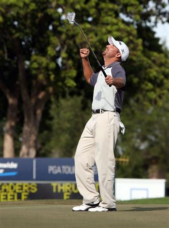 MIAMI - OCTOBER 18:  Chad Collins celebrates his birdie putt on the 18th hole during the final round of the 2009 Nationwide Tour Miccosukee Championship at the Miccosukee Golf & Country Club on October 18, 2009 in Miami, Florida. Collins birdied the 72nd hole in regulation to win by one stroke.  (Photo by Doug Benc/Getty Images)