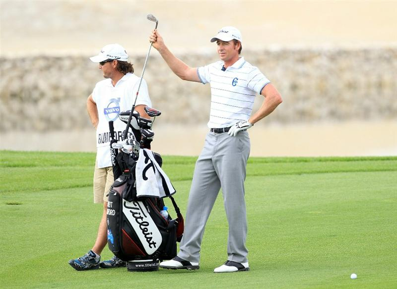 BAHRAIN, BAHRAIN - JANUARY 28:  Brett Rumford of Australia plays his second shot at the 17th hole during the second round of the 2011 Volvo Champions held at the Royal Golf Club on January 28, 2011 in Bahrain, Bahrain.  (Photo by David Cannon/Getty Images)