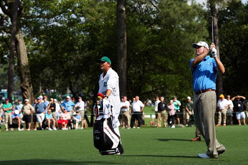 AUGUSTA, GA - APRIL 11:  Chad Campbell watches his third shot on the eighth hole alongside his caddie Judd Burkett during the third round of the 2009 Masters Tournament at Augusta National Golf Club on April 11, 2009 in Augusta, Georgia.  (Photo by Andrew Redington/Getty Images)