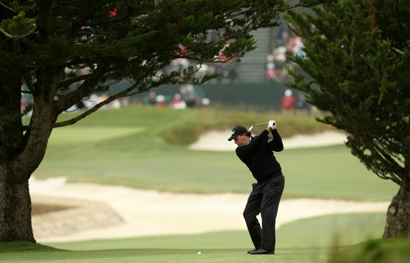 PEBBLE BEACH, CA - JUNE 15:  Phil Mickelson hits a shot during a practice round prior to the start of the 110th U.S. Open at Pebble Beach Golf Links on June 15, 2010 in Pebble Beach, California.  (Photo by Ross Kinnaird/Getty Images)