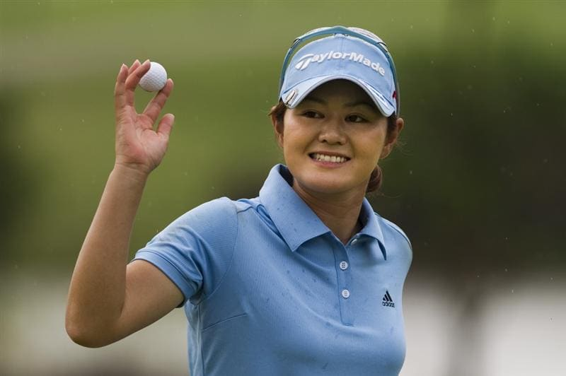 CHON BURI, THAILAND - FEBRUARY 20:  Shinobu Moromizato of Japan acknowledges the crowd on the 8th green during round three of the Honda PTT LPGA Thailand at Siam Country Club on February 20, 2010 in Chon Buri, Thailand.  (Photo by Victor Fraile/Getty Images)