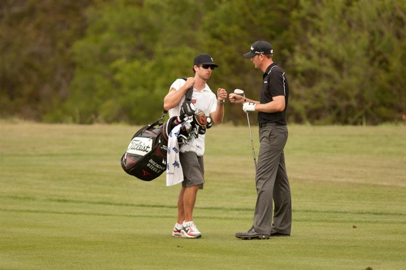 SAN ANTONIO, TX - APRIL 17: Brendan Steele celebrates with caddie Nick Wilkins during the final round of the Valero Texas Open at the AT&T Oaks Course at TPC San Antonio on April 17, 2011 in San Antonio, Texas. (Photo by Darren Carroll/Getty Images)