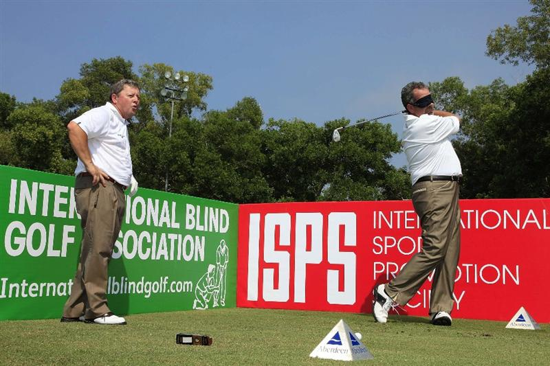 JERUDONG, BRUNEI DARUSSALAM - MARCH 03:  Ian Woosnam of Wales watches as Sam Torrance of Scotland plays blindfolded prior to the start of the Aberdeen Brunei Senior Masters played on March 3, 2010 in Jerudong, Brunei Darussalam.  (Photo by Phil Inglis/Getty Images)