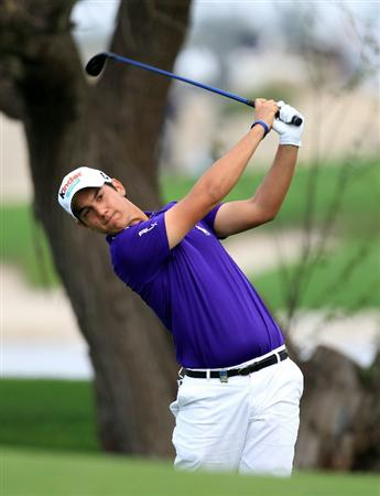 BAHRAIN, BAHRAIN - JANUARY 28:  Matteo Manassero of Italy plays his second shot at the 15th hole during the second round of the 2011 Volvo Champions held at the Royal Golf Club on January 28, 2011 in Bahrain, Bahrain.  (Photo by David Cannon/Getty Images)