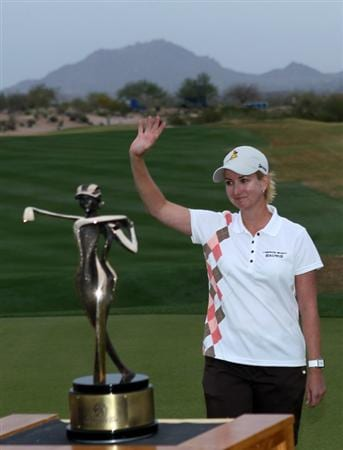PHOENIX, AZ - MARCH 20:  Karrie Webb of Australia waves to the gallery as she stands near the championship trophy after the final round of the RR Donnelley LPGA Founders Cup at Wildfire Golf Club on March 20, 2011 in Phoenix, Arizona.  (Photo by Stephen Dunn/Getty Images)