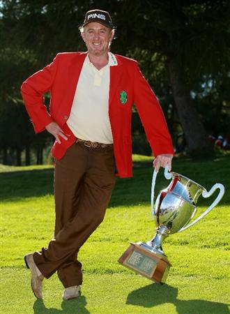 CRANS, SWITZERLAND - SEPTEMBER 05:  Miguel Angel Jimenez of Spain poses with the trophy after winning The Omega European Masters on a score of -21 under par at Crans-Sur-Sierre Golf Club on September 5, 2010 in Crans Montana, Switzerland.  (Photo by Warren Little/Getty Images)