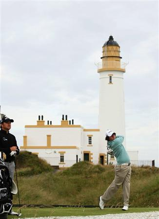 TURNBERRY, SCOTLAND - JULY 13:  Rory McIlroy of Northern Ireland plays on the 10th hole watched by Graeme McDowell during the practice round of the 138th Open Championship on July 13, 2009 on the Ailsa Course, Turnberry Golf Club, Turnberry, Scotland.  (Photo by Ross Kinnaird/Getty Images)