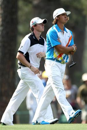 AUGUSTA, GA - APRIL 08:  (R-L) Rickie Fowler and Rory McIlroy of Northern Ireland walk up the 14th hole together during the second round of the 2011 Masters Tournament at Augusta National Golf Club on April 8, 2011 in Augusta, Georgia.  (Photo by Andrew Redington/Getty Images)