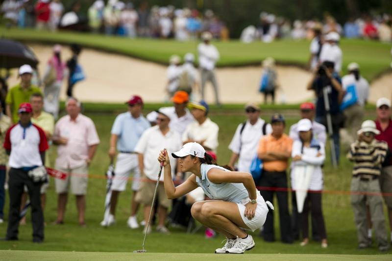 CHON BURI, THAILAND - FEBRUARY 21:  Michelle Wie of USA lines up a putt on the 10th green during the final round of the Honda PTT LPGA Thailand at Siam Country Club on February 21, 2010 in Chon Buri, Thailand.  (Photo by Victor Fraile/Getty Images)
